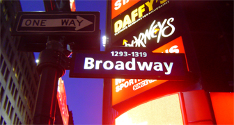 Broadway, as the name implies, is a wide avenue in New York City, and is the oldest north-south main thoroughfare in the city, dating to the first New Amsterdam settlement. The name Broadway is an English translation of the Dutch name, Breede weg. The street is famous as the pinnacle of the American theater industry