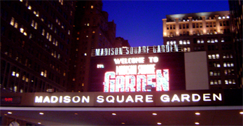 Madison Square Garden, often abbreviated as MSG, known colloquially simply as The Garden, has been the name of four arenas in New York City, NY. It is also the name of the entity which owns the arena and several of the professional sports franchises which play there. There have been four incarnations of the arena. The first two were located at the Northeast corner of Madison Square (Madison Ave. & 26th St.) from which the arena derived its the name